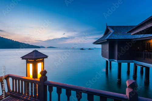 Fotografia, Obraz Peaceful and quiet view of the ocean with wooden houses on stilts at the Straits