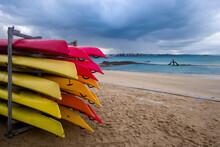 Colorful Kayaks On The Beach O...