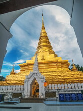 View Of Golden Pagoda With Cloudy Sky Background, Wat Phra That Chae Haeng, Nan Province, Northern Of Thailand.