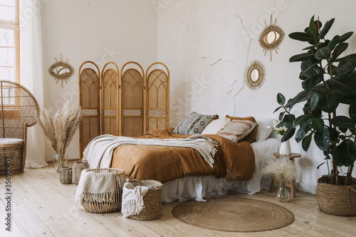 Obraz Comfort apartment in bohemian style interior with hygge bedroom - fototapety do salonu
