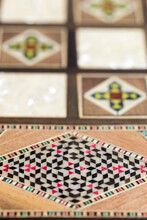 Vertical Close-up Detail Of Delicate Handcrafted Fine Wood Trinket Box, Luxury Marquetry And Mother Of Pearl Inlaid Case With Colorful Geometric Pattern, Used For Jewelry Or Valuables