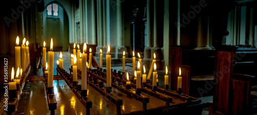 Candlestick with burning candles in a church