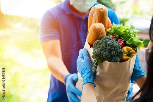 Fototapeta Food service providers wear masks