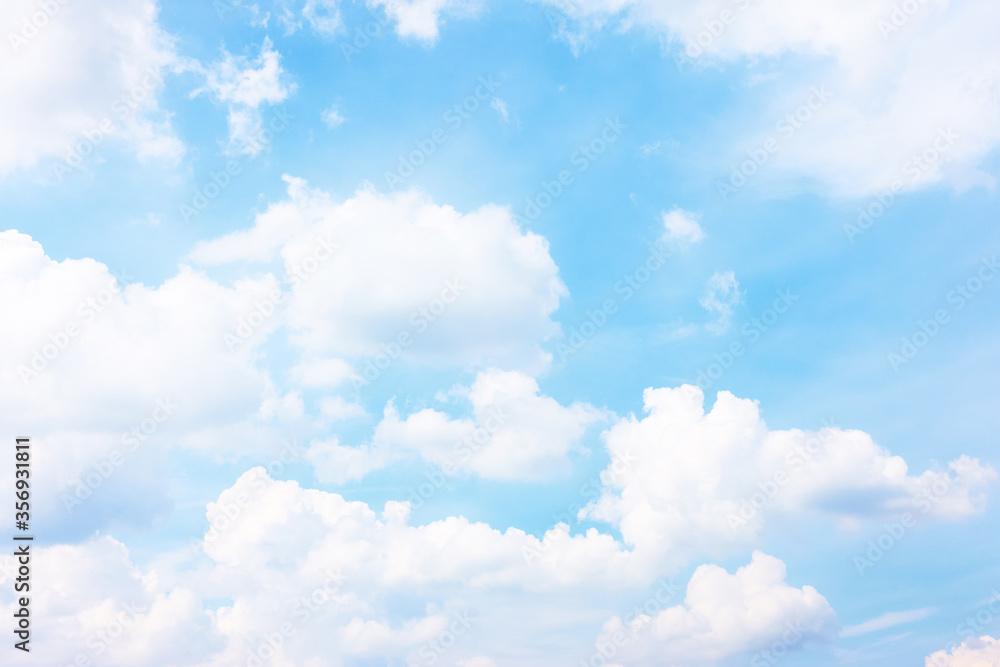 Fototapeta Pastel blue sky with white haep clouds