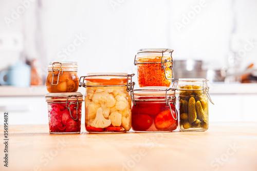 Fototapeta The jars of delicious homemade pickled vegetables obraz