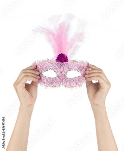Photo Hand holding Glitter Mardi Gras Feather Mask isolated on white background