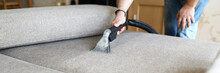 Hoovering Sofa With Vapor Clea...