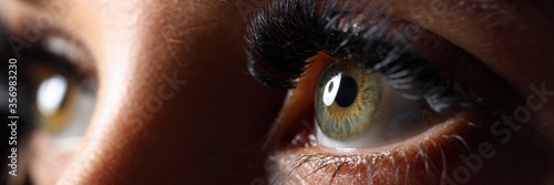 Amazing female green colored eyes with eyelashes extensions Fotobehang