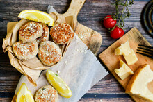 Home Made Italian  Chicken  Meatballs  With Parmesan Cheese, Chily Peppers And Fresh  Lemon On  Rustic Background. Diet Food.