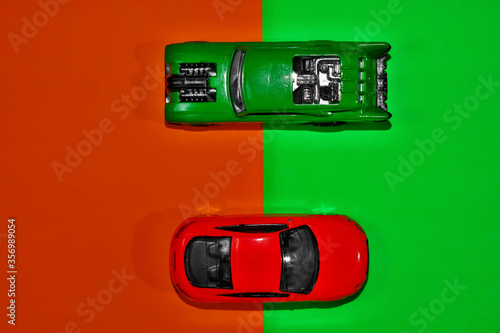 Toy cars on green and red background with high angle view Tablou Canvas