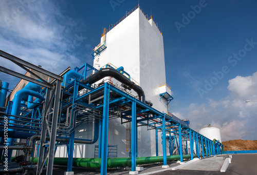Air-separating factory for producing industrial gases, blue pipes Canvas Print