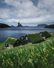 Black Wooden Houses With A Gre...