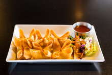 Crab Rangoon On A Tray With Si...