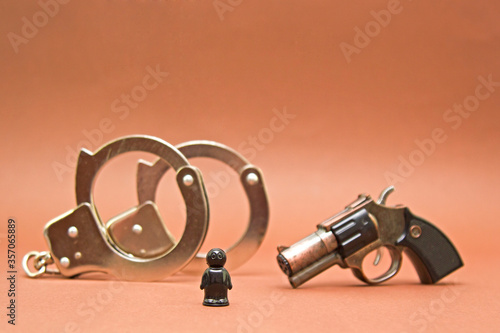 Photo handcuffs weapons and the arrest of a black man, anti-Semitism and racism, racia