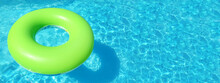 Bright Inflatable Ring Floating In Swimming Pool On Sunny Day, Space For Text. Banner Design