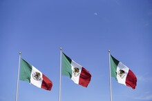 Three Mexican Flags Under The ...