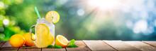 Cold Glass Of Lemonade On Wood...