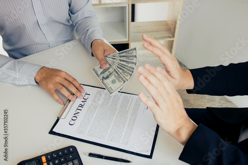 Businessperson refusing bribe given money by partner with anti bribery corruption concept Fototapeta