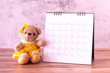 Teddy Bear With Calendar On Ta...