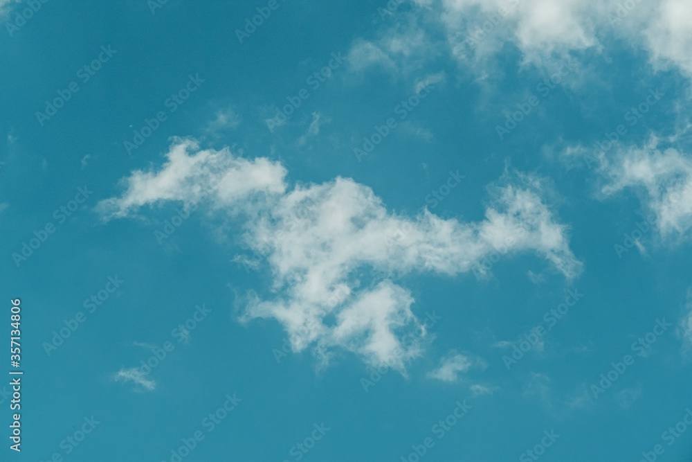 Fototapeta Landscape shot of the clear blue sky with some clouds