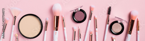 Set of makeup brushes and facial cosmetics isolated on pink background Poster Mural XXL