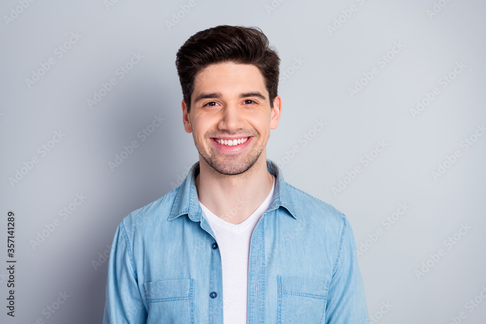 Fototapeta Closeup photo of macho attractive guy perfect appearance neat hairdo bristle smiling toothy wear casual blue denim shirt isolated grey color background