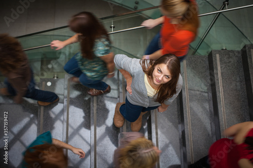 At the university/college - Students rushing up and down a busy stairway - confi Canvas Print