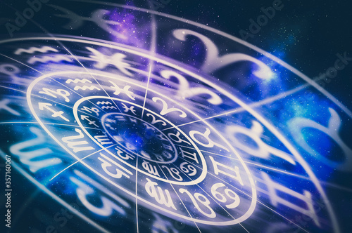 Zodiac signs inside of horoscope circle on universe background Canvas Print