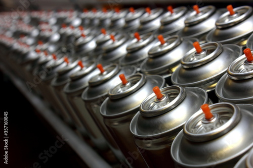 Photo Aerosol cans on production line in factory