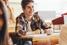 Teenage Boy Smiling During Lec...