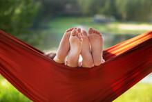 Children's Feet In A Hammock