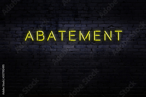 Neon sign. Word abatement against brick wall. Night view Canvas Print