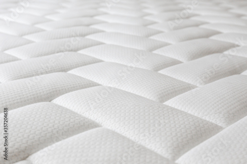 Close up shot of white orthopedic mattress top side surface pattern with a lot of copy space for text Fototapeta