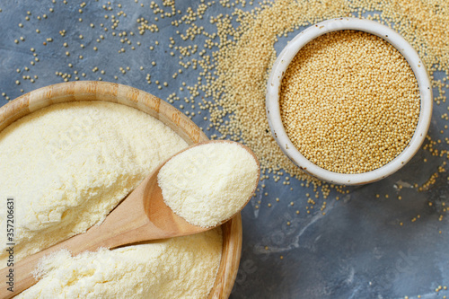 Bowl of raw Amaranth flour with a spoon and bowl of Amaranth seeds Wallpaper Mural