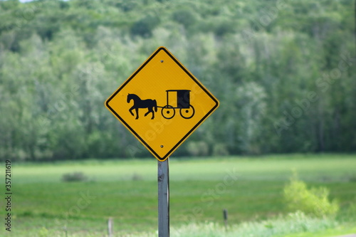 Photo Horse & Buggy warning sign on road to alert motorists