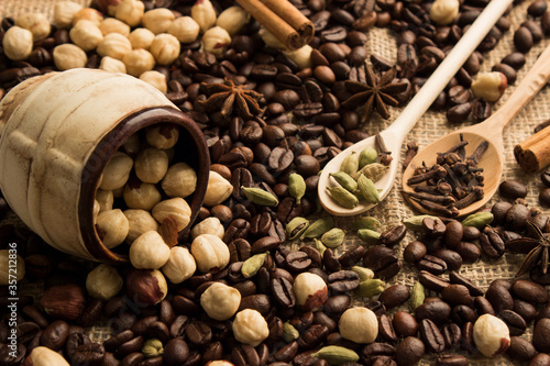 Fototapeta coffee beans with hazelnuts and spices obraz