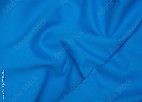 Creased blue gabardine. Rumpled texture. Folded fabric Fototapeta