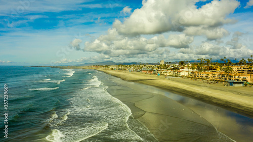 Aerial view of the beach and dramatic clouds at Oceanside, California Canvas Print