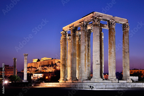 The Temple of Olympian Zeus (considered one of the biggest of the ancient world) in the blue hour, with Acropolis in the background Wallpaper Mural