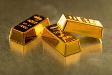 Three Golden Bars On Metal
