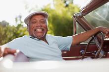 Smiling Older Man Driving Convertible