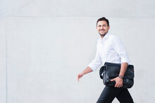Smiling Businessman With Lapto...