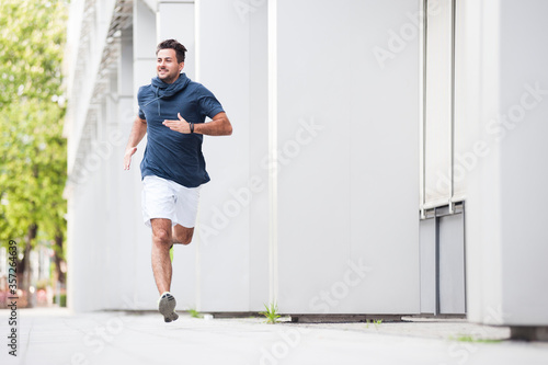Young man jogging in the city - 357264639