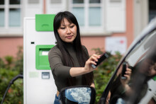 Carsharing, Woman Renting An E...