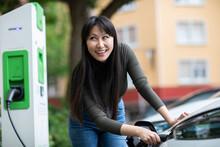 Carsharing, Woman Charging An ...