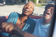 canvas print picture - Older couple laughing in convertible