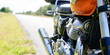 canvas print picture - Vintage motorcycle exhaust pipes engine chrome aside road in concept roadtrip