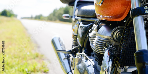 Vintage motorcycle exhaust pipes engine chrome aside road in concept roadtrip Slika na platnu