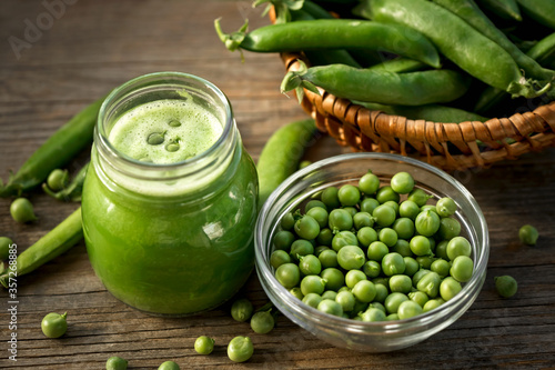 Cream of green pea soup in a glass jar Fototapete