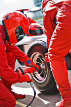 Racing Team Working At Pit Stop